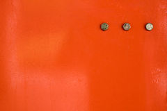 Metal vermelho com parafuso fotografia de stock