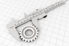 Metal Vernier Caliper over Graph Paper Royalty Free Stock Photography