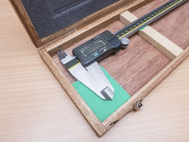 Metal vernier caliper in wooden box package Stock Photos