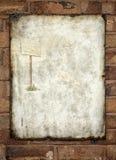 Metal vintage enamel advertisement sign on wall Royalty Free Stock Photos