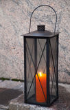 Metal vintage lamp with red candle inside Stock Image