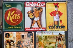 Metal vintage posters souvenirs for tourists on the streets of the city. MADRID, SPAIN - 27 MARCH, 2018: Metal vintage posters souvenirs for tourists on the Stock Photo