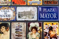 Metal vintage posters souvenirs for tourists on the streets of the city. MADRID, SPAIN - 27 MARCH, 2018: Metal vintage posters souvenirs for tourists on the Royalty Free Stock Images