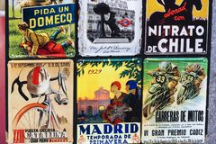 Metal vintage posters souvenirs for tourists on the streets of the city. MADRID, SPAIN - 27 MARCH, 2018: Metal vintage posters souvenirs for tourists on the Stock Images