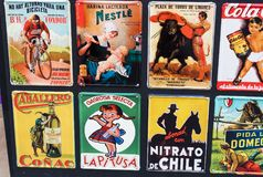 Metal vintage posters souvenirs for tourists on the streets of the city. MADRID, SPAIN - 27 MARCH, 2018: Metal vintage posters souvenirs for tourists on the Royalty Free Stock Image
