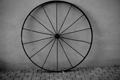 The metal wagon wheel. Stock Photo