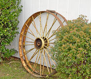 Metal Wagon Wheels Leaning on Wall Royalty Free Stock Photography
