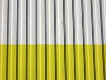 Metal wall. White yellow metal wall royalty free stock image