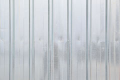Metal wall background. Steel fence with some reflections. Stock Image