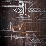 Metal wall with a chalky technical drawings. Abstract background texture: rusted metal wall with a chalky technical drawings on it Royalty Free Stock Photos