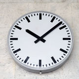 Metal wall clock. Royalty Free Stock Images