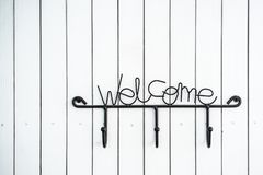 Metal Wall Mounted Coat Rack And White Wooden Stock Image