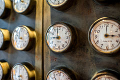 Metal wall with old styled clocks Royalty Free Stock Image