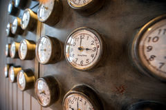 Metal wall with old styled clocks Royalty Free Stock Photo