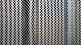 Metal wall profile with round holes as background Stock Photography