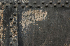 Metal wall with rivets Royalty Free Stock Images