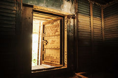 Metal walls and open heavy steel door Royalty Free Stock Photography