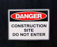 Warning Sign; Danger, Construction Site. A metal warning sign on a building site hoarding; Danger, Construction Site, Do Not Enter stock image