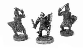 Metal warriors. Metal toy figures of warriors royalty free stock image