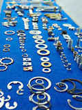 Metal washers, clamps, gaskets, screws Stock Photography
