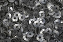 Metal washers Grover under nuts bolts chrome stock photography