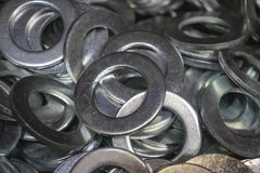 Metal washers Grover under nuts bolts chrome stock photo
