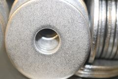 Metal washers macro selective focus - some face on and others from side view - background royalty free stock photo