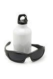 Metal water flask and sporty sunglasses Stock Photos