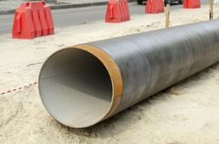 Metal water pipe, large diameter, prepared for laying for sewer. Lying on the street royalty free stock photography
