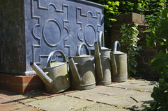 Metal watering cans Stock Images