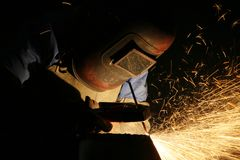 Metal Welder Working. A metal welder at work with sparks flying Royalty Free Stock Image