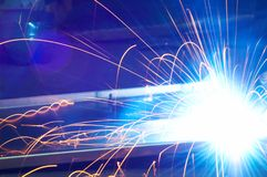 Metal Welding with sparks. Metal Welding with sparks closeup selective focus Royalty Free Stock Images