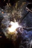 Metal welding sparks flash smoke Stock Photo