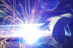 Metal Welding with sparks. Metal Welding with sparks closeup selective focus Royalty Free Stock Image