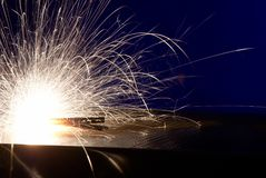 Metal Welding with sparks. Closeup selective focus Stock Image