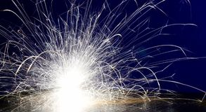 Metal Welding with sparks. Closeup selective focus Royalty Free Stock Photo