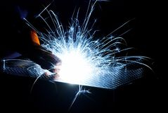 Metal Welding with sparks. Metal Welding with sparks closeup selective focus Stock Photos