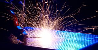 Metal Welding with sparks. Metal Welding with sparks closeup selective focus Stock Photography