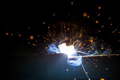 Metal Welding with sparks and smoke Royalty Free Stock Images