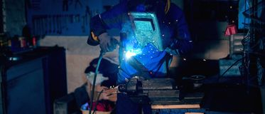 Metal welding in workshop. Metal welding in workshop, one male welder Stock Photo