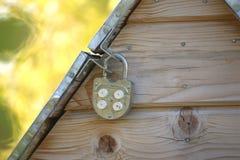 Metal well door closed on padlock Royalty Free Stock Image