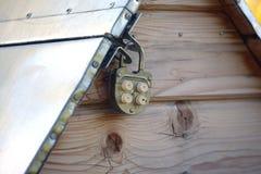 Metal well door closed on padlock Stock Photography