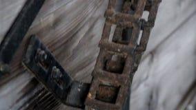 A metal wheel and axle bike chain turned rusty Stock Photo