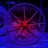 Metal wheel in coloured light Stock Photography