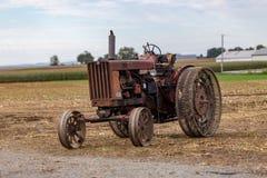 Metal Wheels on Farm Tractor stock photos