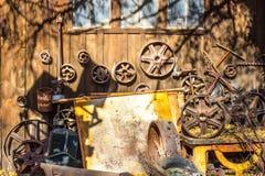 Metal Wheels & Junk At Salvage Yard. Collection Of Rusted Metal Wheels & Junk Laying Around In Salvage Yard Stock Photos
