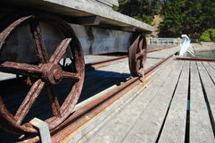 Metal wheels of old wagon on pier Royalty Free Stock Photography