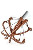 Metal whisk with chocolate Royalty Free Stock Photography
