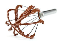 Metal whisk with chocolate Stock Image