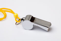 Metal whistle. A metal whistle on a white background Stock Photo